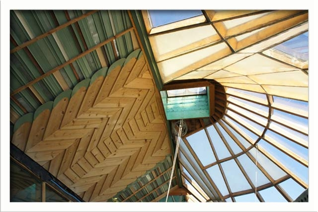 An opening in the greenhouse roof helps to regulate temperature