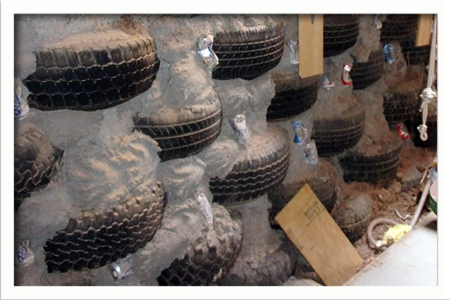 Filled tires stacked in the northern section of the home create structure and thermal mass